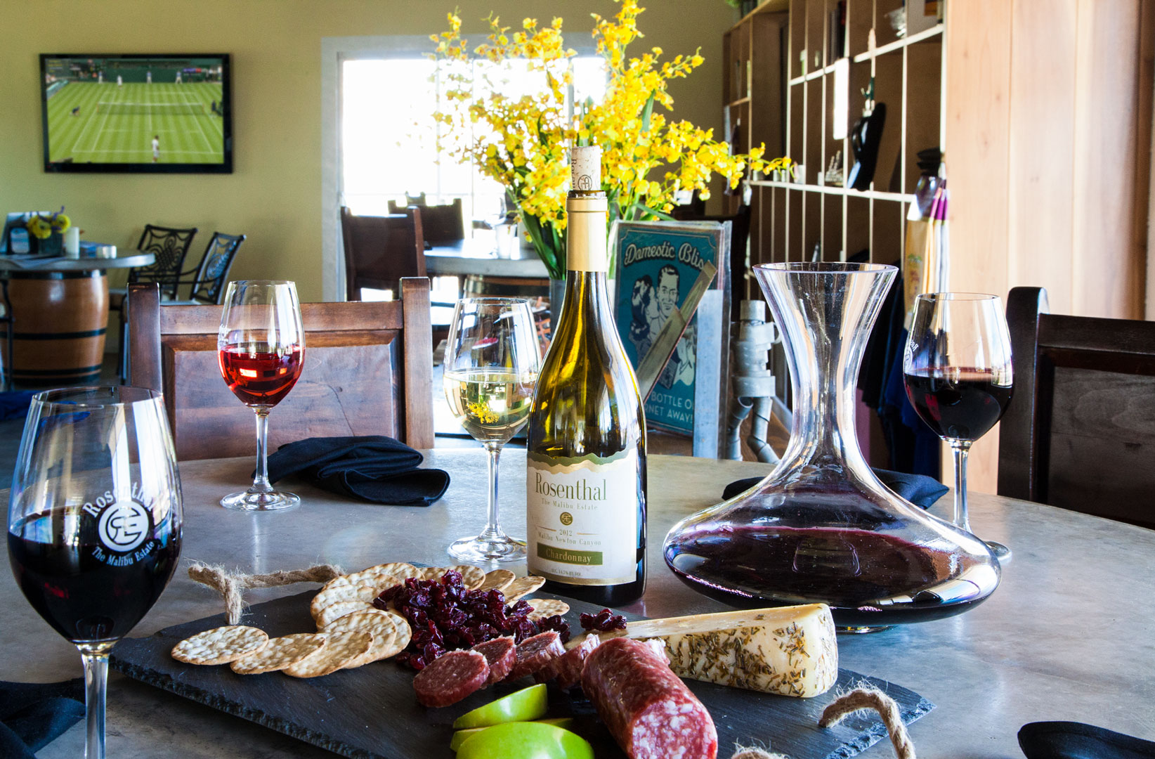 Table inside the tasting room with food. Los Angeles wines, Southern California Wines, malibu vineyard
