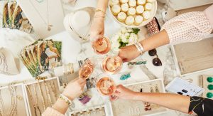 Guests enjoying a toast with wine glasses and jewelry in the picture